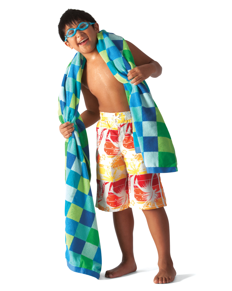 Young boy in swimsuit with towel.