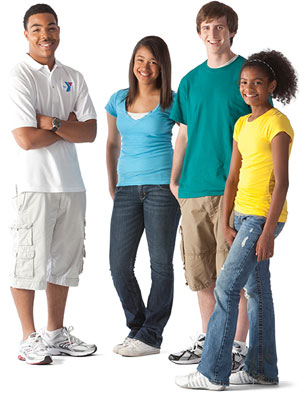 Adult staff member posing with three teenagers in a youth education and leadership class.