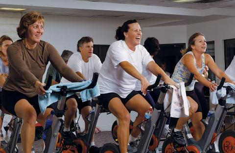 Ladies spinning on bikes.