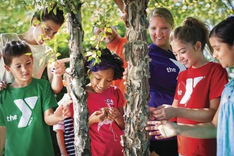 Diverse children participating in outdoor activities.