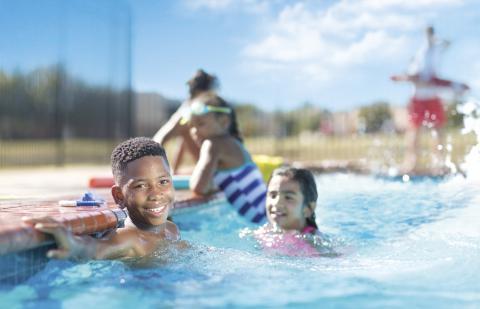 Children enjoying their time in a pool.