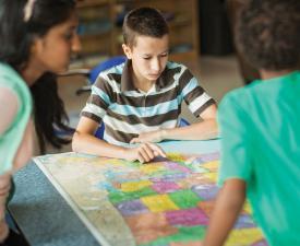 children reading map